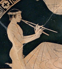 image of Greek pottery showing a man playing an aulos