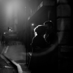 couple embracing in a night street scene