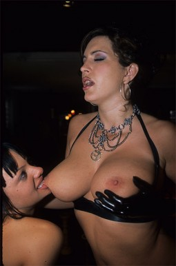 Belladonna biting another topless woman's nipple