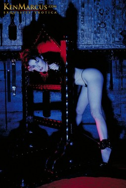 dita von teese nude in thong and restrained in a head and wrist pillory stock fetish image