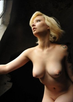 blonde with porcelain skin and pierced nipples