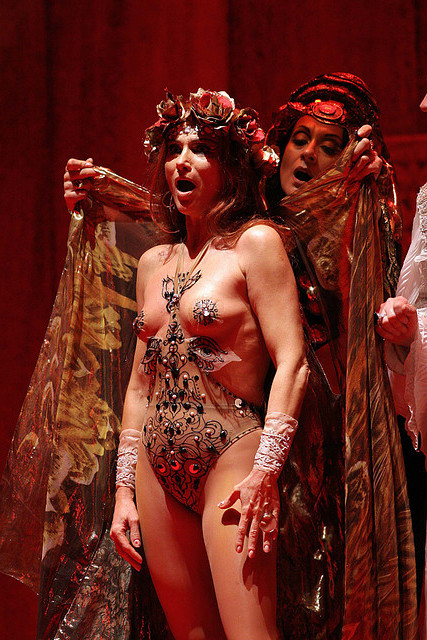 soprano Francesca Patanè nude with pasties being draped in a robe in salome