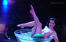 another image of dita von teese splashing in a martini glass for her burlesque routine at the San Remo