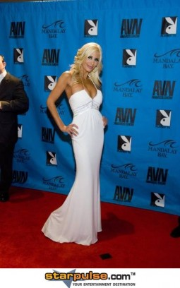 puma swede on the red carpet wearing along white evening gown