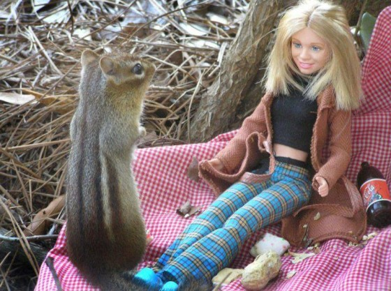 chipmunk looking at suggestively dressed Barbie doll