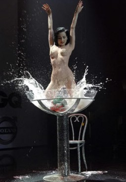 dita von teese splashing in a martini glass for her burlesque routine