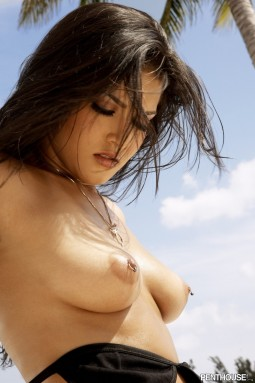brunette brazilian beach babe topless with pierced nipples
