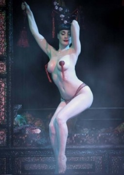 Dita Von Teese dancing topless with pasties and g-string at The Opium Den club
