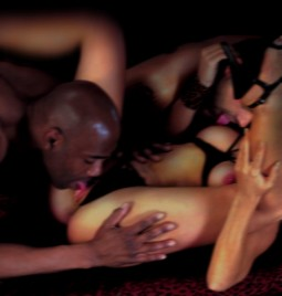 interracial sex threesome with black man licking pussy of white woman in black lingerie while white man licks her nipple