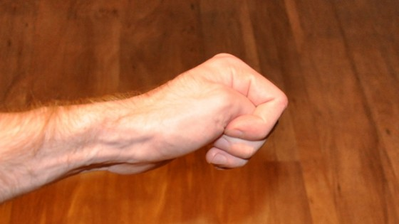 image of how to grip thumb in left fist to suppress the gag reflex