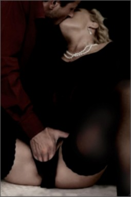 clothed sex with woman in black dress and pearls having her pussy fingered by clothed man