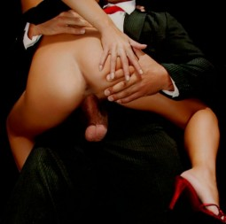 clothed sex with man in suit sitting with woman facing him riding and fucking him cowgirl style with her dress pulled up