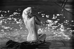 Marilyn Monroe back shot sitting nude by a pool