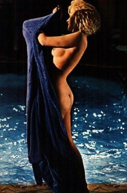 Marilyn Monroe nude by swimming pool with blue towel showing side breast