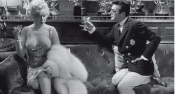 Marilyn Monroe in a scene from Some Like It Hot with Tony Curtis and wearing an apparently see through dress