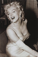 Marilyn Monroe laughing and showing deep cleavage in a sparkling ball gown