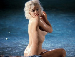 color image of Marilyn Monroe nude side shot in shallow water at a pool