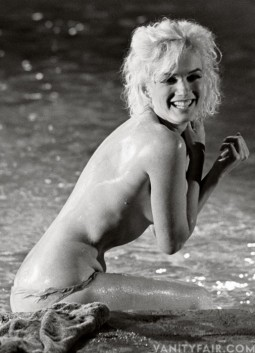 Marilyn Monroe nude and smiling in a swimming pool