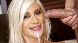 Puma Swede smiling while a big messy cumshot drips off her chin