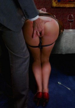 man in a suit fingering from behind pussy of bent over woman with her skirt pulled up