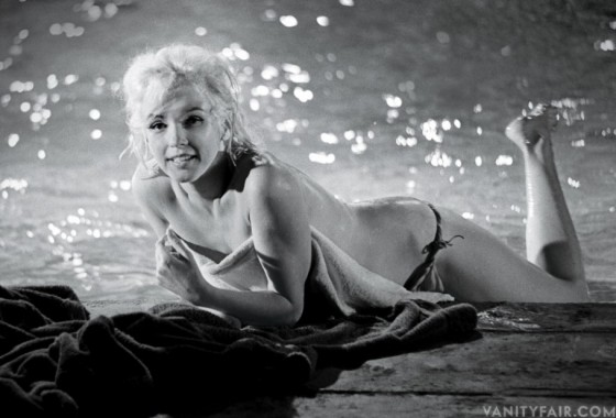 a black and white image of Marilyn Monroe topless by the pool from the movie Something's Gotta Give