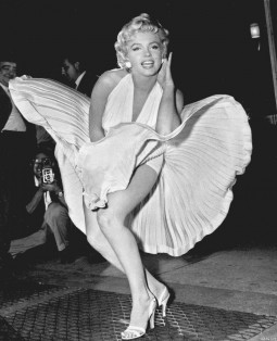 image of Marilyn Monroe with her skirt blowing up showing her legs and underwear