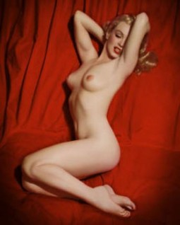 Marilyn Monroe nude with a red backdrop the famous Playboy photo