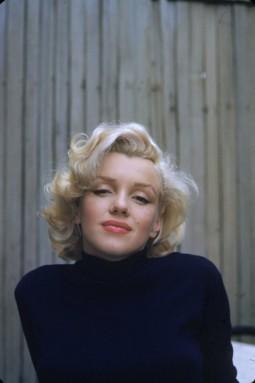 headshot portrait of Marilyn Monroe in a black turtleneck