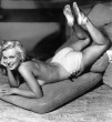 marilyn monroe lying in her stomach topless and tanned