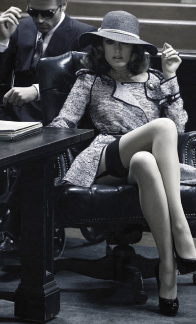 woman sitting seductively in court with legs crossed showing stocking tops