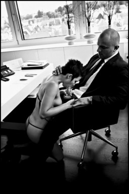CMNF sex with man in suit and tie sitting in office in his chair while nude woman kneels in front of him and sucks his cock