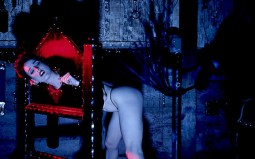 dita von teese in thong and restrained in a pillory stock fetish dungeon stting