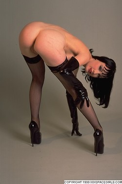 Dita Von Teese bent over looking back at the camera, wearing only stockings and heels showing her bare ass