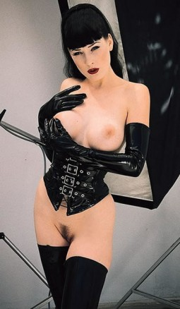 Dita wearing black gloves and corset with bare pussy and tits, pinching her nipple