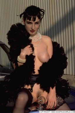 Dita showing her breast sitting on the hood of a Mercedes sedan with her pussy up close to the hood ornament