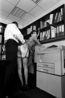 man in office clothes fucking woman in the ass as she is bent over filing cabinets with her skirt pulled up