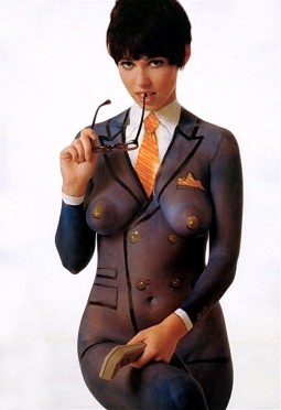 nude woman with body painted on suit, shirt and orange tie