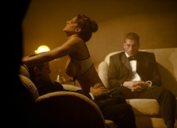 clothed sex CMNF image of woman fucking a man in a tux while a second man in a tux watches