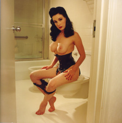 dita-corset-boobs-out-sitting-toilet