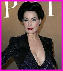 Dita Von Teese showing great hair and cleavage