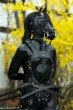 a person wearing a black full fetish pony horse play costume including realistic horse head