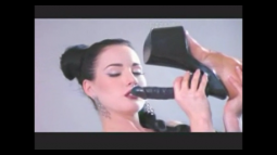 screenshot of dita sucking a high heel dildo shoe