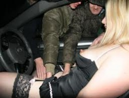 woman in lingerie in car seat with men reaching through window to touch her pussy - dogging car sex