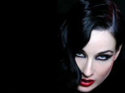 head shot portrait of Dita Von Teese showing her white complexion and black hair
