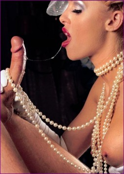 woman wearing multiple long strands of pearls and pearl necklace blowing a big cock
