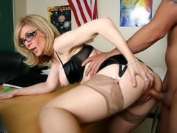Nina Hartley in glasses and lingerie getting fucked bent over a desk