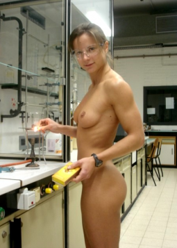 girl standing in science lab nude except for safety glasses