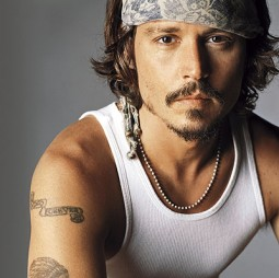 head and shoulders shot of Johnny Depp in tee shirt and bandana