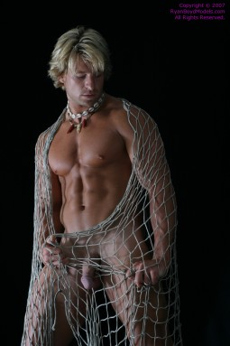 hot nude man draped in a heavy fisherman's net