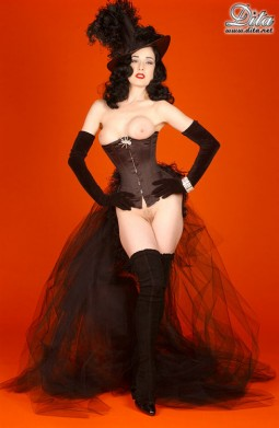 Dita in a black bustier with long train bustle showing her pussy and boobs